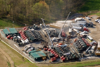 """Large menagerie of diesel powered equipment 'fracking' a gas well in 2010. In addition to all the PM2.5 air pollution, silica dust, millions of gallons of water that flows back toxic (being laced with frac chemicals--many are proprietary """"secret"""" formulas while others are known endocrine disruptors), heavy metals, brine, and radioactive elements like Ra226 and Ra228. Fracking and wastewater disposal have even created earthquakes in some states."""