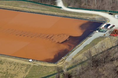 Five years after the shale drilling boom got underway, football field size wastewater impoundments dotted Washington County, Pa, similar to this one in 2013. It was soon discovered how many of them leaked and how very little everyone knew about the chemicals and pollutants contained in those fluids.