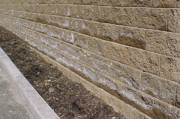 Efflorescence on a precast wall. Sometimes you'll also see this problem on brick walls.