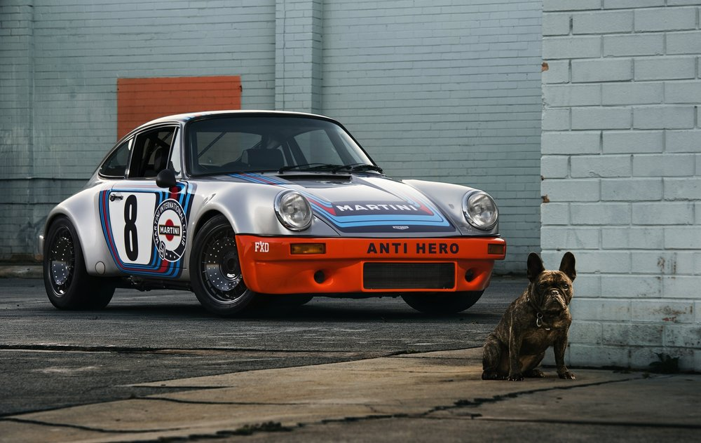 "The number ' Eight'  from one of the famous 'Mary Stuart' RSRs proudly displayed on this beautiful Outlaw build.   Brendan came up with the idea of retro fitting the BBS style wheel fans to his own race car, and we applied it to this outlaw.  ""What dog?"""