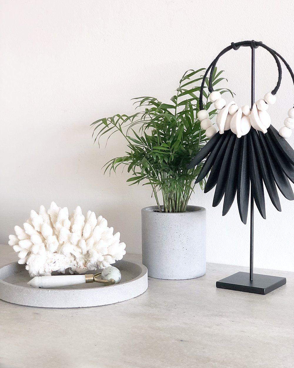 Cuttle + Cowrie in Black, Coral, Jade roller & Concrete pot + tray. Things we LOVE.
