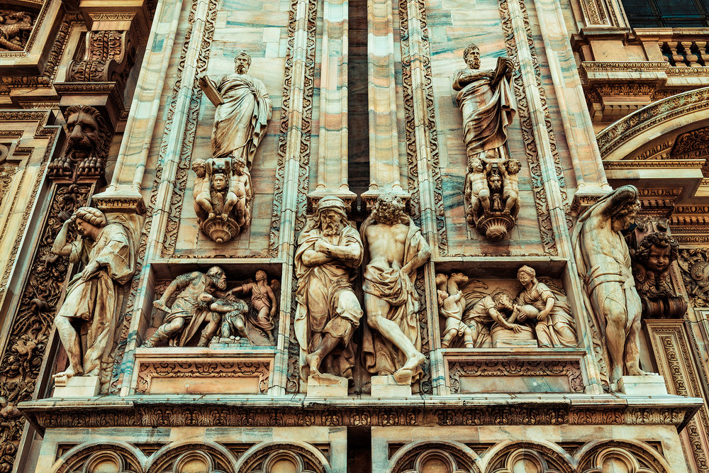 © Guild Magazine - 2018. The Duomo's façade is constructed of Candoglia Marble, with multiple carvings and sculptures decorating the exterior as well as interior of the cathedral.