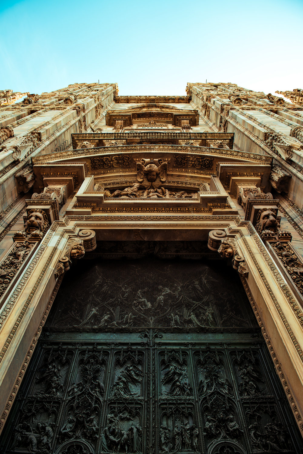 © Guild Magazine - 2018. Though it took approximately 600 years for the Duomo to be constructed (with multiple architects and designers involved in this process), the main doors are relatively new, dating from the 20th century. Nevertheless, they hold true to Pellegrino Tibaldi's original 16th century design.