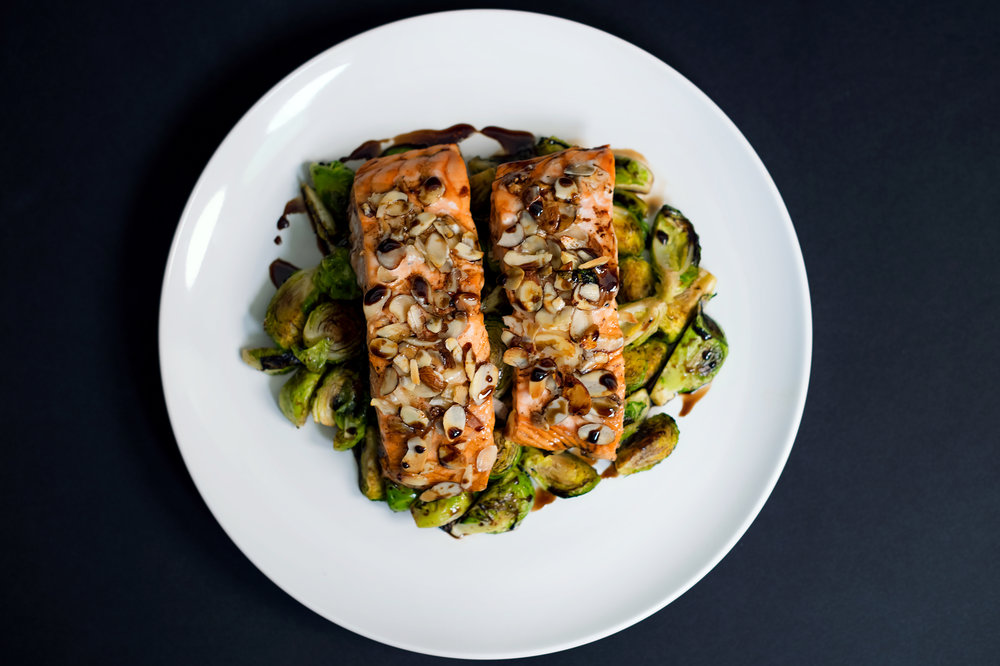 Almond - Crusted Salmon with Balsamic-Maple Glazed Brussel Sprouts. - © Guild Magazine - 2018.