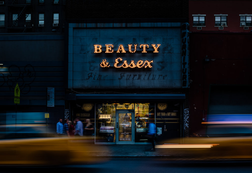 The innovative design of  Beauty & Essex  starts in the restaurant's entrance with a well-curated modern day Pawn Shop replete with a saxophone, boom-box, and quirky artifacts.