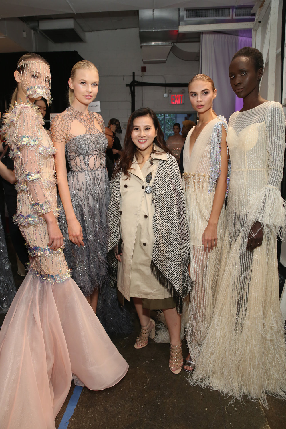 Designer Ruby Fang poses with models backstage at the Ruby Fang fashion show during September 2018 New York Fashion Week: The Shows at Industria Studios in New York City. (Photo by Monica Schipper/Getty Images for Ruby Fang)