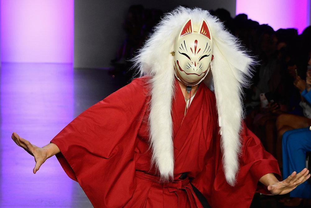 NYFW / DAN LIU. Designer Dan Liu performs a samurai dance before his show. Dan Liu. @ Getty Image.