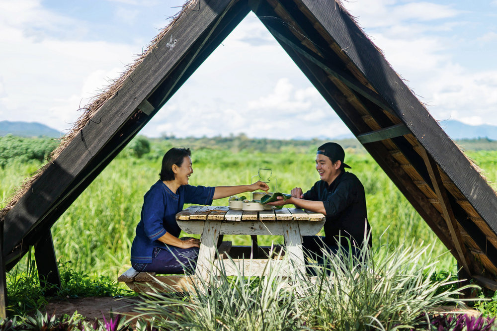 A Local Expert (pictured) opened up her home and shared her home-cooked meal with a traveler for the LocalTable campaign by Tourism Authority of Thailand and TakeMeTour. © Take Me Tour.