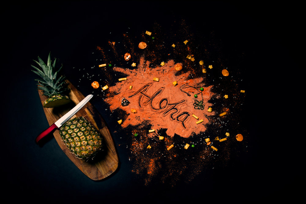 Pineapple Aloha Splash.  Although not inherently a fruit of Hawai'i, pineapples have come to be recognized as a fruit of the islands. John Kidwell is credited with the introduction of the pineapple industry to Hawai'i. It can be enjoyed with Li'hing Mui, a red plum powder used to garnish pineapples and other fruits. Picture: Guild Magazine - Copyright 2018.