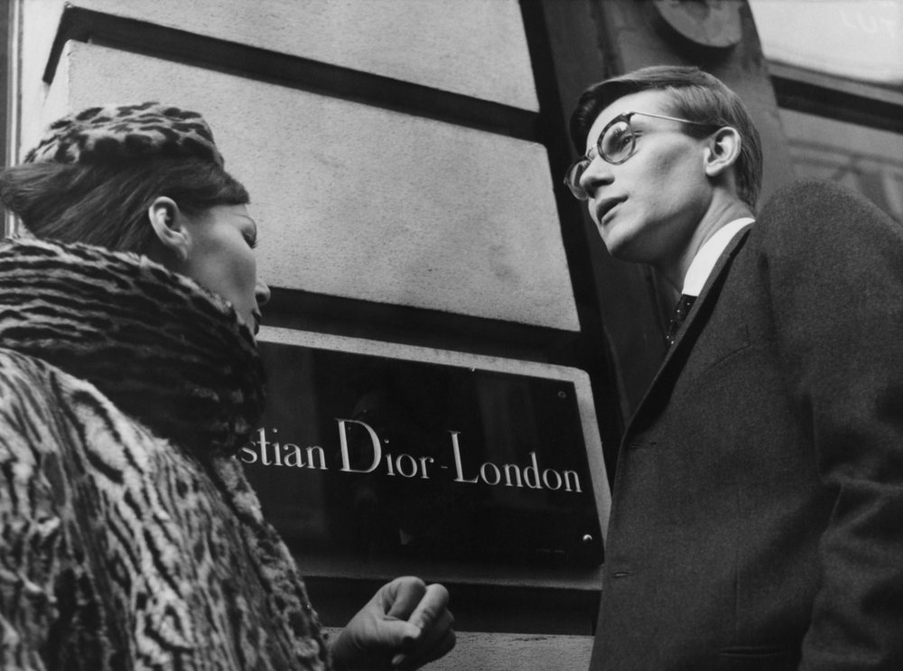 Yves Saint Laurent in front of Christian Dior London, 11th November 1958. © Popperfoto. Courtesy of Christian V&A.