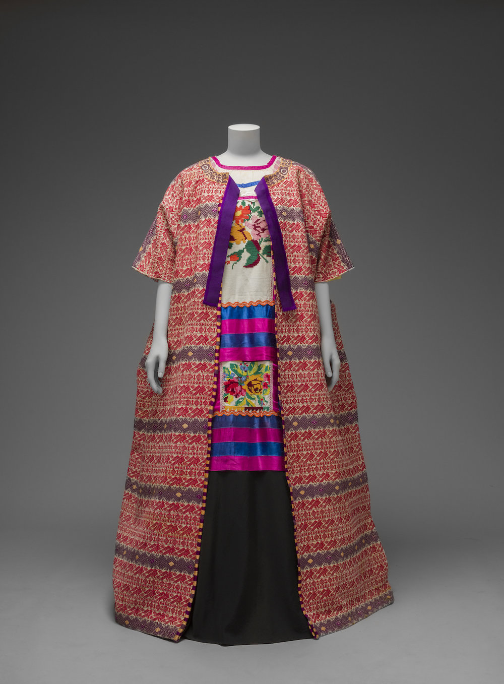 Guatemalan cotton coat worn with Mazatec huipil and plain floor- length skirt Museo Frida Kahlo. © Diego Rivera and Frida Kahlo Archives, Banco de México, Fiduciary of the Trust of the Diego Riviera and Frida Kahlo Museums.