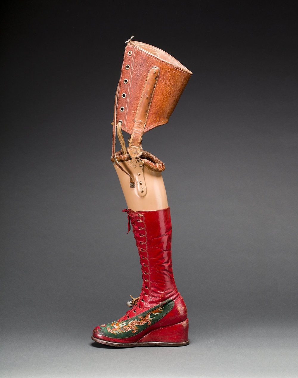 Prosthetic leg with leather boot. Appliquéd silk with embroidered Chinese motifs. Photograph Javier Hinojosa. Museo Frida Kahlo. © Diego Riviera and Frida Kahlo Archives, Banco de México, Fiduciary of the Trust of the Diego Riviera and Frida Kahlo Museums.