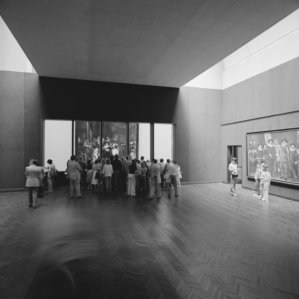 Visitors inspecting the progress of the restoration of The Night Watch through the windows in 1975-76.
