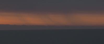 Moody rain over sunrise beach.jpeg