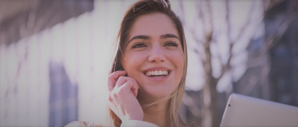 Smiling woman using unified communications
