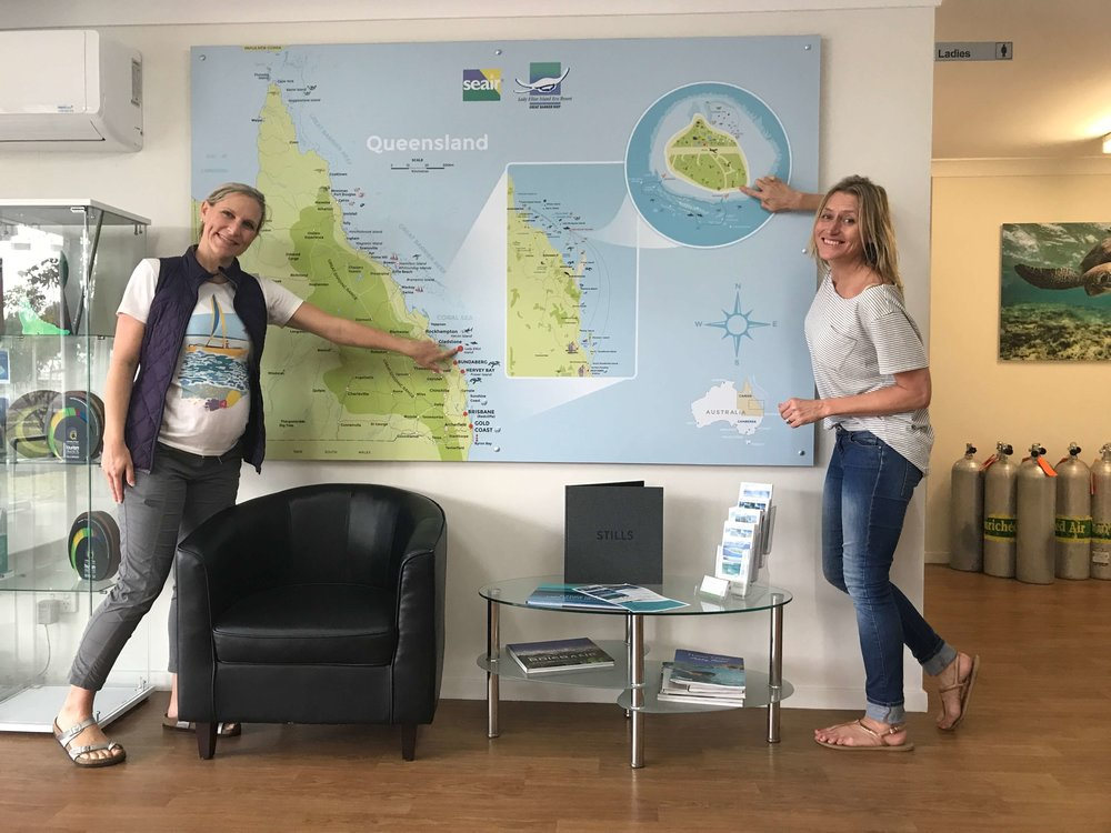 The completed wall map graphic installed at the Seair office