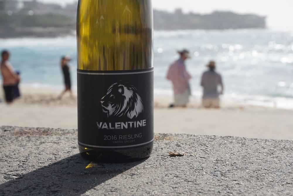 2016 Valentine Riesling 2-2.5T/acre  Sourced from 21 year old vines, the fruit was handpicked on the 3rd March and whole bunch pressed to ⅓ old French puncheon and ⅔ stainless steel. Spontaneous fermentation by indigenous yeasts and arrested when sugar (2 g/L), acid and phenolics were all in balance. Maturation on gross lees until filtration in February 2016.  The whole bunch pressing, wild yeast, 4% skin contact & old french oak usage during fermentation gives the wine weight, texture and finesse on the palate. It shows its own unique character of place.  Bottled unfined and with a total of 60ppm total sulphur.  2016 Valentine Riesling is layered and complex. The colour shows its youth through a vibrant & bright hue. It exhibits a range of fresh characters on the nose including melon, nectarine and floral notes. There are hints of soft citrus in the background but this Riesling is not your typical lemon lime zing thing. It's much, much more.  The long fermentation has resulted in an aromatic, dry and crisp wine with a slight spritz. This wine is lean and lively with awesome length and a delicious, intricate finish.  Please note, whilst we have good stocks of the '16 they are allocating fast. 2017 went to bottle around 4-5 weeks ago and is ready for release also.  We also have limited stocks available of 2013 (Magnum) and 2014 (750ml).