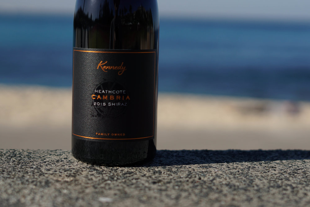 2015 Kennedy 'Cambria' Barrel Selection   100% Shiraz 2T/acre  Handpicked as bunches at 240m elevation on Cambrian soils (Iron rich with jasper, chert, seafloor basalt/greenstone). Shiraz is 70% destemmed whilst the remaining 30% remains as wholebunches, the fruit undergoes 4 days of cold soak before wild fermentation commences in open top stainless steel vessels for a total of 7 days. Gentle pumpovers occur once daily for first 2-3 days followed by hand plunging until pressing   The wine remains on skins for a total of 18 days before being pressed to a combination of old French oak and 20% new French oak. Here, the resulting wine completes full malolactic fermentation and matures on lees for a total of 13 months before it is racked to rest again in oak for an additional 6 months.  Unfined, unfiltered and 53mg/l SO2 added.
