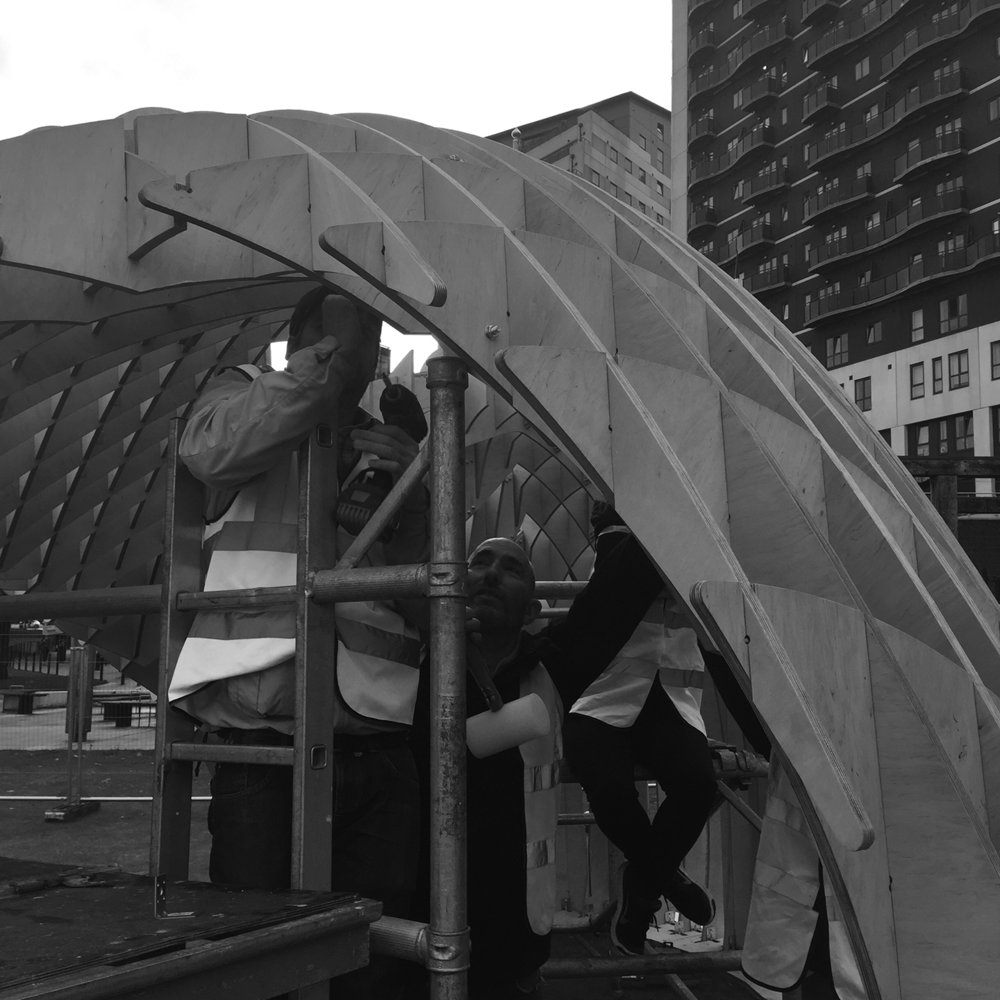 Steve Snell at the Dual Works helping Intervention Architecture constuct a pavillion.jpg