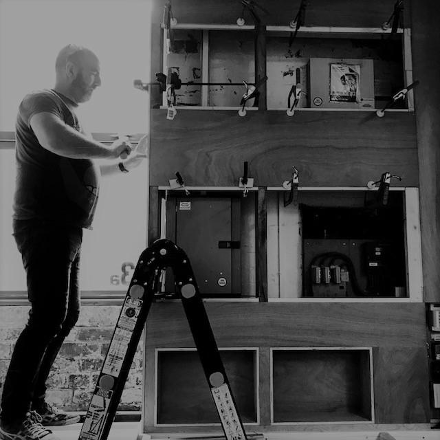 Dual Works Steve building our studio showroom.jpg