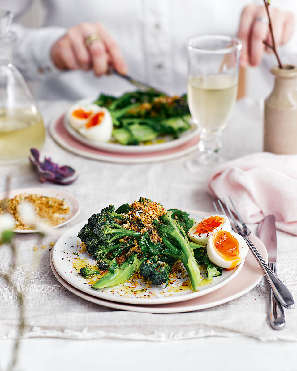 Purple sprouting broccoli with soft boiled eggs and crumbs