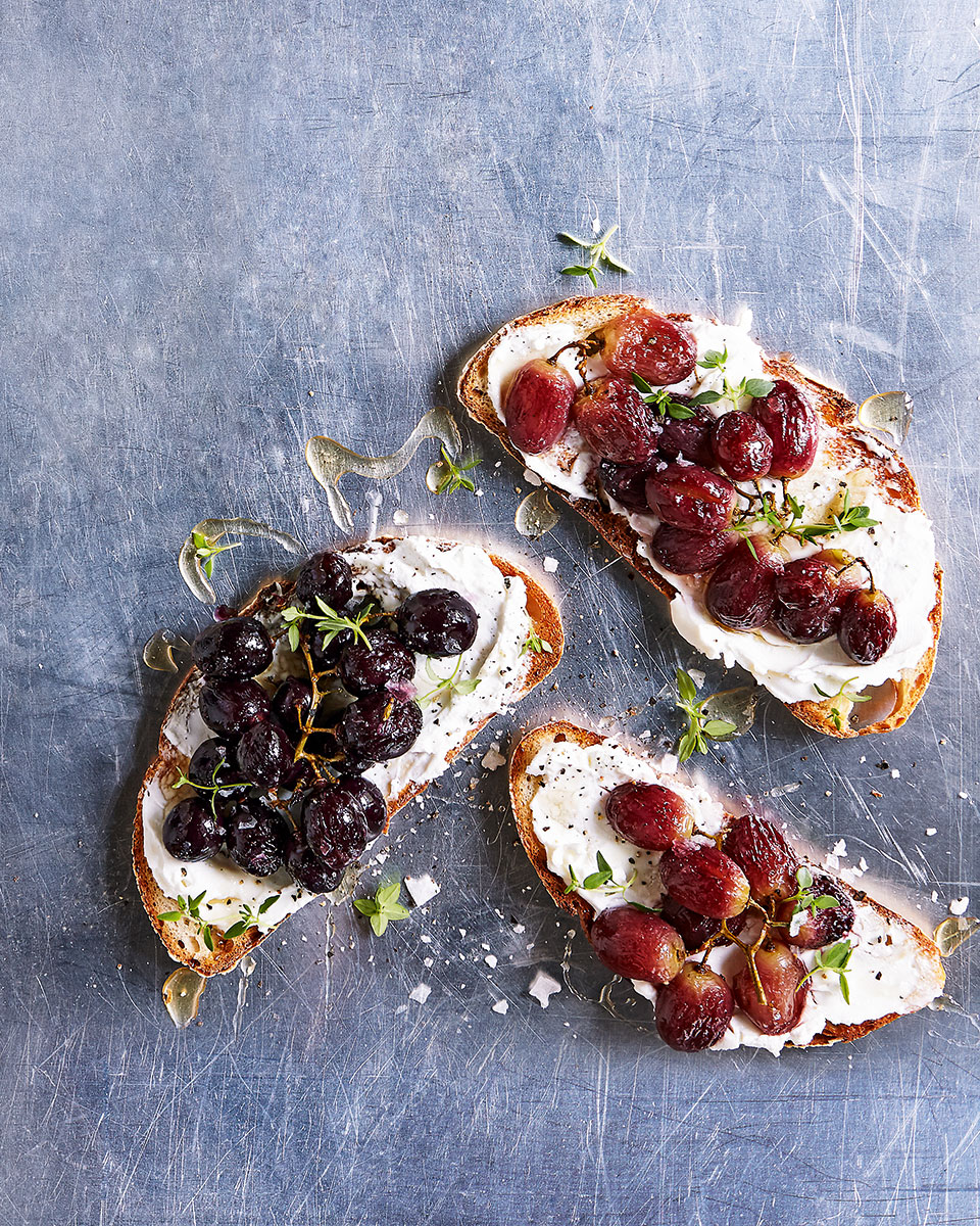 Roast grapes on toast with honey, thyme and goats curd