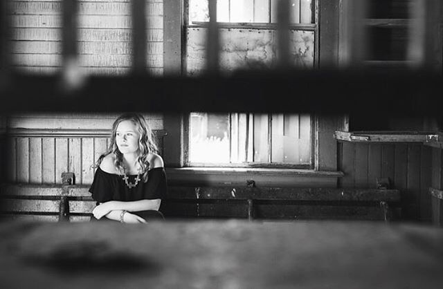 Not your typical senior photo but i had to post it. We took this on their property in western South Dakota at an old post office/stagecoach. I took the pic looking through the window where people would come get their mail or tickets and she is sitting on the original bench that was in there.  Sounds funny, but i wish the building could talk to us. I'm sure there are so many cool stories that took place there.  Thanks @jamieneugebauer for such a fun day! You are beautiful...inside and out!