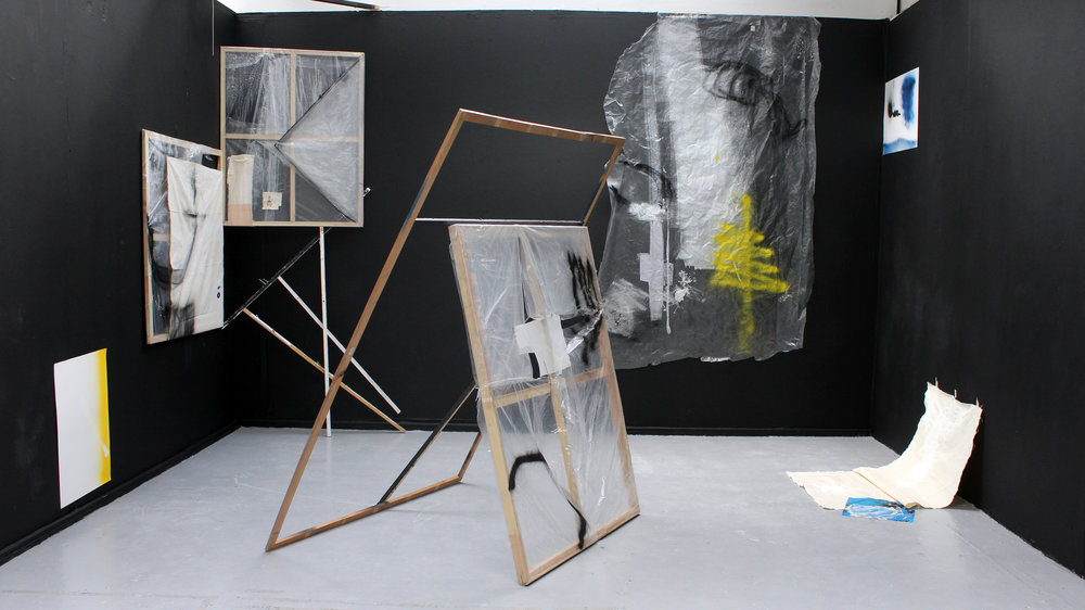 "'Untitled: Installation' 2018 (above) Installation View: canvas, plastic sheets, paper, wood, nails, spray paint, gesso, acrylic, thread. Works from ""Controlled Chance"" (bottom left and top right spray paint on paper).  ""Frame and Canvas"" (Left 2 canvas frames and wooden structure, middle sculpture and bottom right canvas).   ""Untitled: Clear"" (back right 'plastic sheet')."