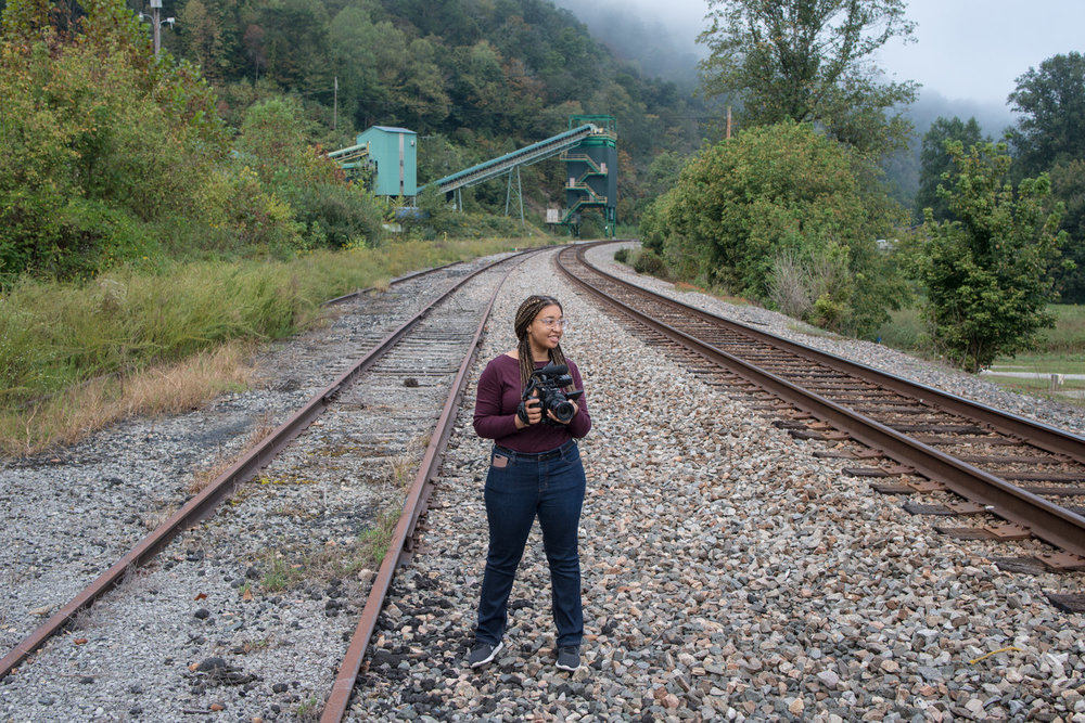 """Reporter Mahlia Posey reports near the Viking Wash Plant in Justiceville, Kentucky as part of The GroundTruth Project's """"Crossing the Divide"""" reporting project."""