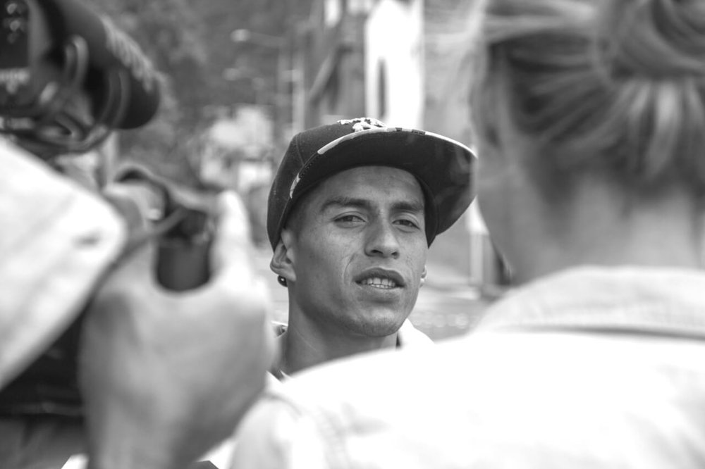 The WorldNomads crew interviewing a street gang leader in La Perservancia