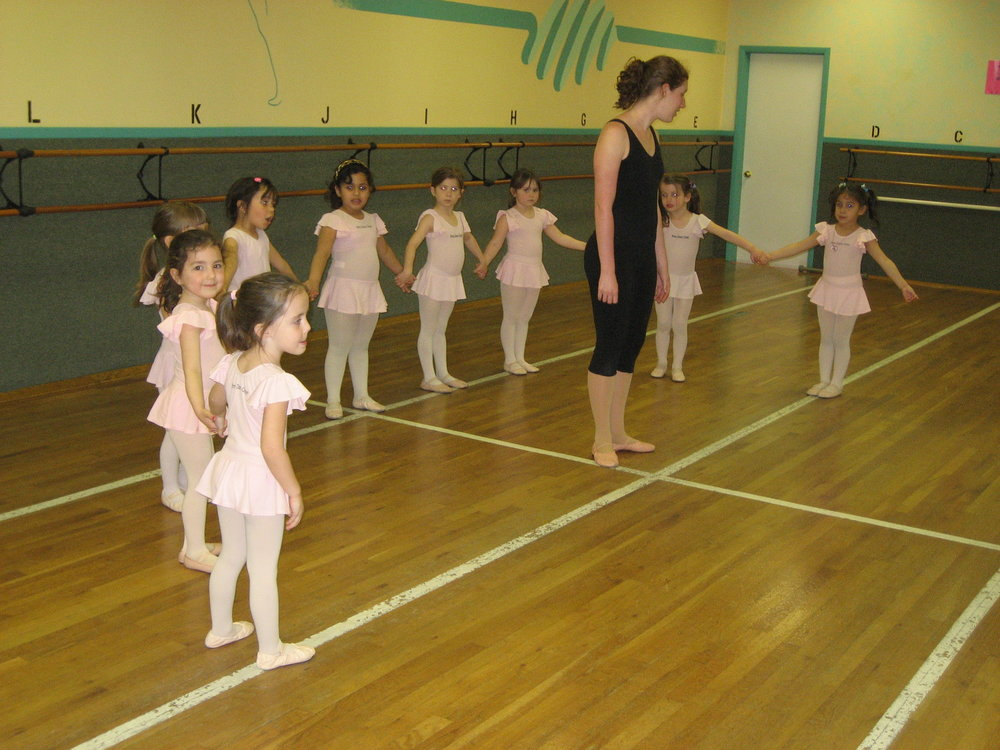 Kinderdance - 4 - 5 year oldsA 1-hour class of ballet and tap introducing formal dance training through proper terminology and technique. It's a fun approach to fundamental ballet technique and basic tap through repetitive movement and muscle memory. Initially the entire class wears a soft ballet shoe - after a few classes, hard work and effort is rewarded with tap shoes and students are ready to execute and hear the tap steps that they have been practicing. Both ballet and tap routines are performed in the annual production.