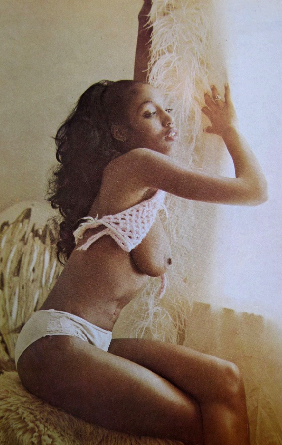 Vintage ebony model with knit top.png