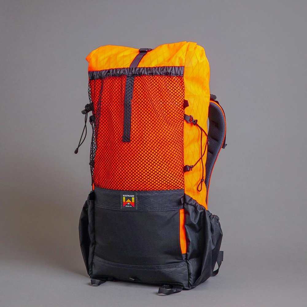 THRU™ 38L with Upper/Lower Front pocket. Heavy duty mesh Upper pocket, Lower Lycra right hand entry stow pocket.
