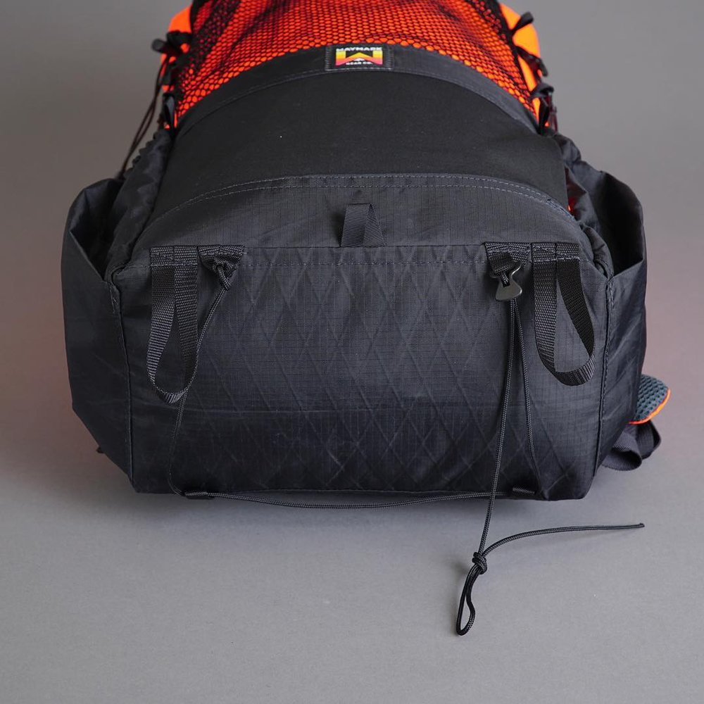 Bottom-of-pack gear straps with 4 point attachment. (pictured with the Ultralight 2mm cord option with Lineloc adjuster. This option allows you to remove and replace the cord if it wears out)