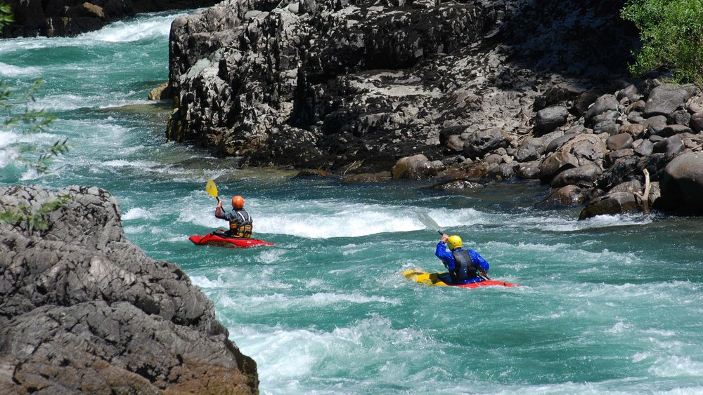 The rapids are caused when the riverbed steepens in gradient, creating an increased acceleration in the water. This is why river rafting often includes steep drops, dramatic twists and turns and layered waterfalls. -