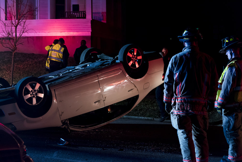 Athens Firefighters gather around a flipped over car on Morris Avenue on February 9, 2019.