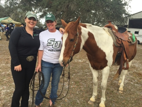 Clare (left) and her Mom (center) in 2018 at Clare's last home collegiate show.