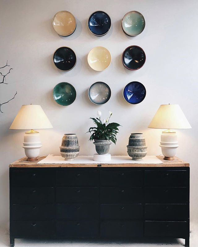 Our Padova bowl wall display is always changing, as newly glazed pieces come out of the studio! #milanolamps #sgraffito #genova #monza #mirimara #ceramics #californiamade #interiordesign #interiordesign #gallery #artwall #handmade #lighting #bowls #vases