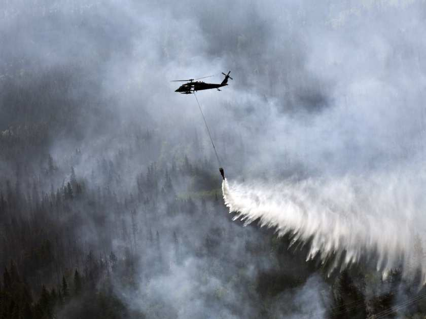 A Bambi Bucket is used to help douse a wildfire in Alaska in 2015. Sgt. Balinda O'Neal / AP