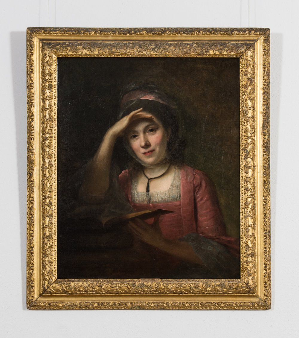 Portrait of a Lady, wearing a red dress, reading a book