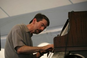 Fred Hersch at the piano.