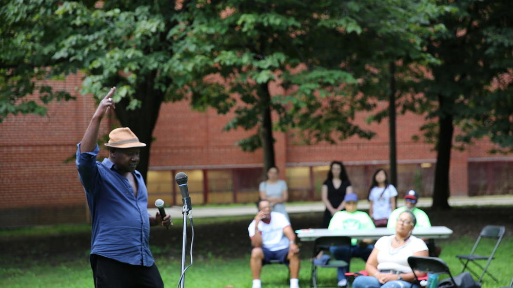 Chicago poet Marvin Tate performs spoken word poetry inspired by audience input at the event.