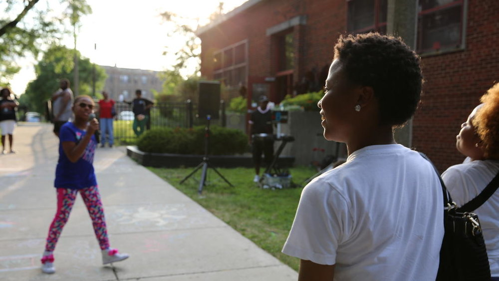 "9-year-old Chicago rapper Ms. Nina performs her song ""Lip Gloss"" for fans at the Washington Park Field House. Ms. Nina and DJ Bsyde were featured in GLMPI'S Sankofa Nights event."