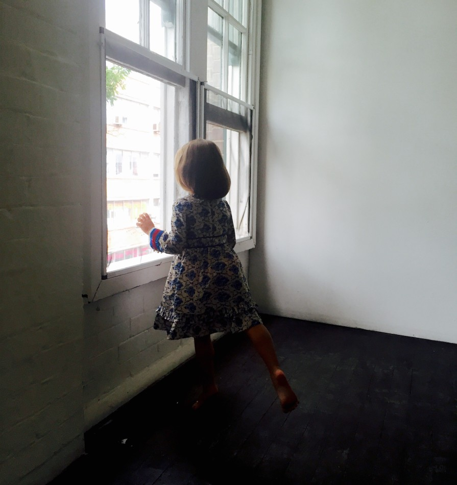Little-Girl-in-window-895x950.jpg