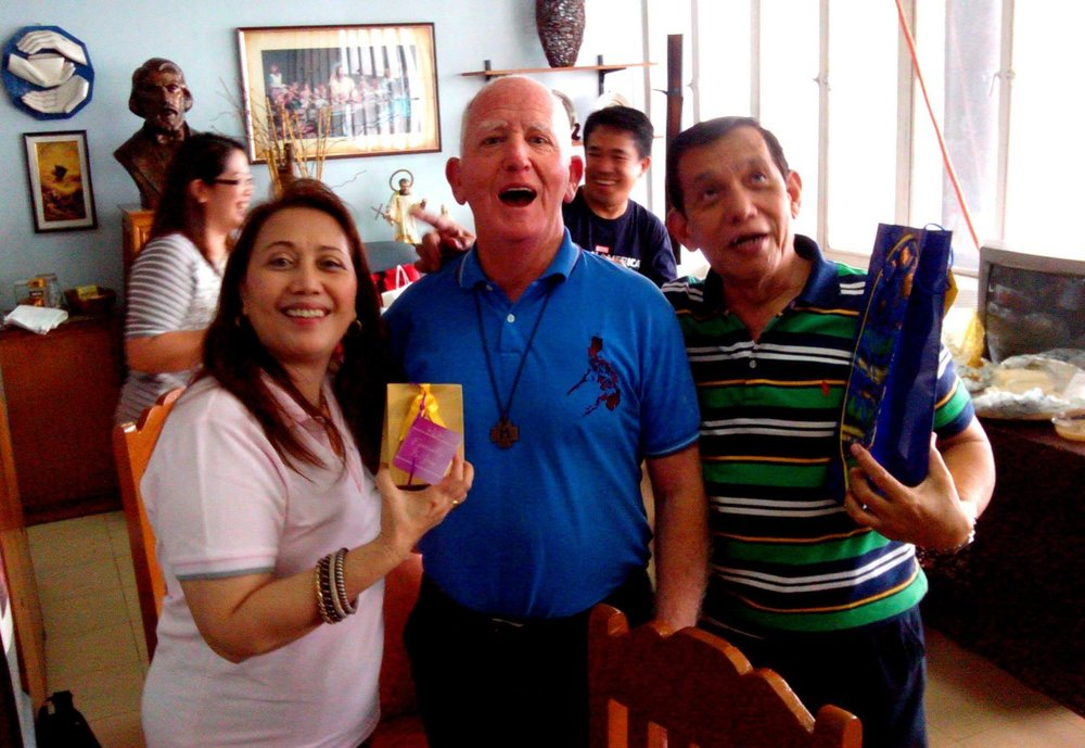Br Doug Walsh (middle) in the Manila office of The Society of St Vincent de Paul, Christmas 2011.