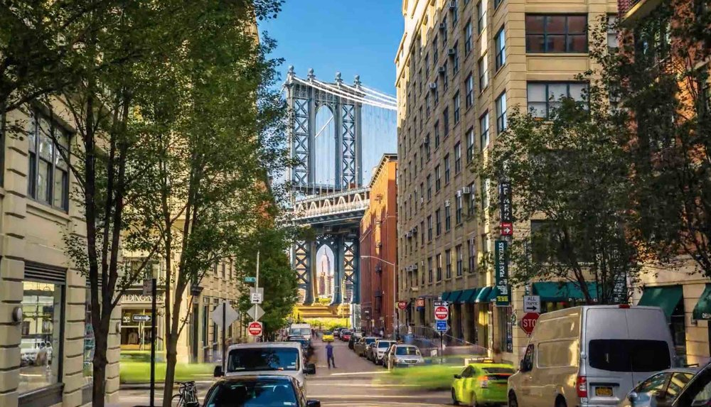 classic view of the manhattan bridge and empire state building – from washington street in dumbo, booklyn