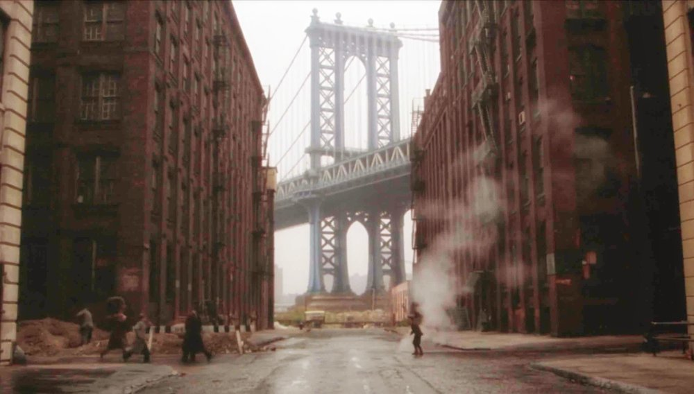 """ once upon a time in america "" is a 1984 Italian-American epic crime drama film co-written and directed by Italian filmmaker Sergio Leone and starring Robert De Niro and James Woods. (location at this picture: washington street, in dumbo, brooklyn, new york"