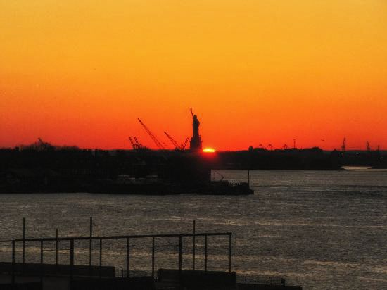 lady liberty witnessing a beautiful sunset