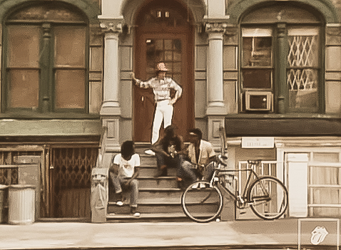 "Mick Jagger on the steps of St. Marks Place in the Rolling Stones' video for ""Waiting On A Friend."""