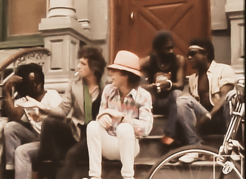 "Mick Jagger and Keith Richards in ""Waiting On A Friend"" video. the guy next to mick jagger is the legendary reggae star Peter Tosh."